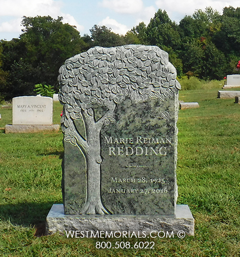 Green granite headstone with hand carved tree design