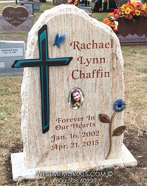 Gold And Gray Headstone With A Bronze Cross Butterfly And