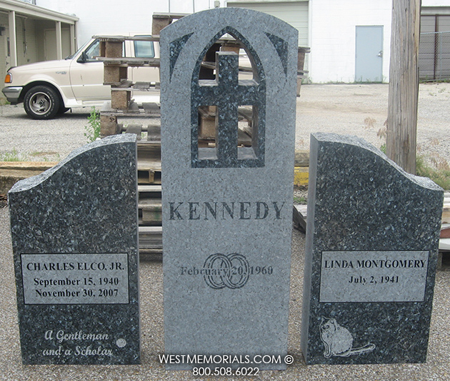 Blue granite double headstone with carved cross