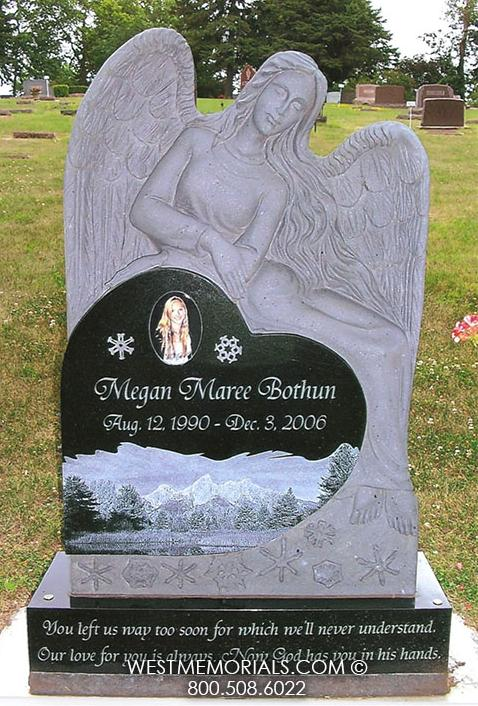 Angel sitting on heart in black granite with etched scenery and snow flakes by West Memorials