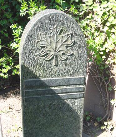 The Abbey headstone is a green textured stone with a leaf carving