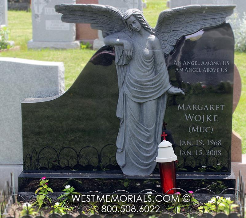 Wojke black granite angel cemetery gravestone wings leaning tall tombstone