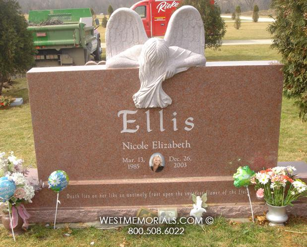 Pink family headstone with weeping angel holding flowers