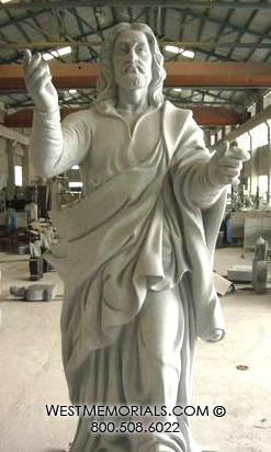 Jesus is hand-carved in gray granite by West Memorials.