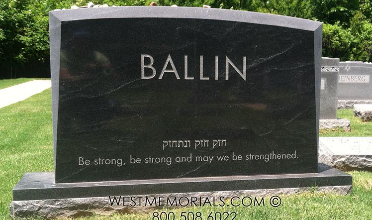 Black granite family monument with beveled edges