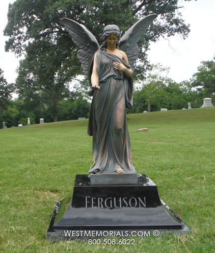 Ferguson cast bronze angel on black granite pedestal monument.