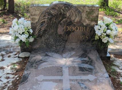 Brown and charcoal granite monument and ledger with palm tree cross and wave. bronze, letters, family, companion, West Memorials